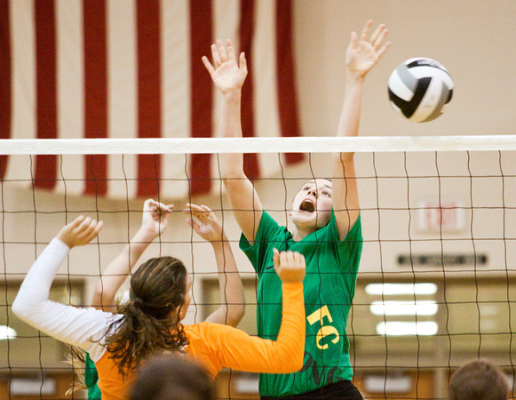 Floyd Central freshman Gwyn Jones blocks a shot by Columbus East senior Sara Bean during the first set of the championship match of the Hoosier Hills Conference volleyball tournament at Floyd Central on Saturday. Columbus East won the match in 2 sets, 26-24, 25-22. Staff photo by Christopher Fryer