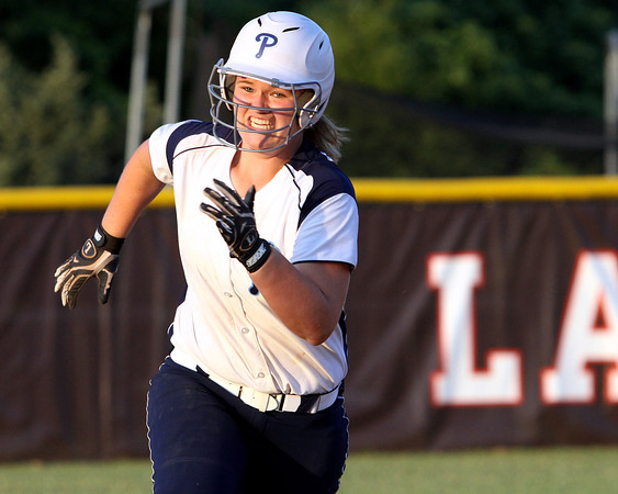 Providence freshman Lillian Hughes legs out a two RBI triple in the fifth inning of the Lady Pioneers' 6-4 2A Sectional championship win over Paoli. Staff photo by C.E. Branham