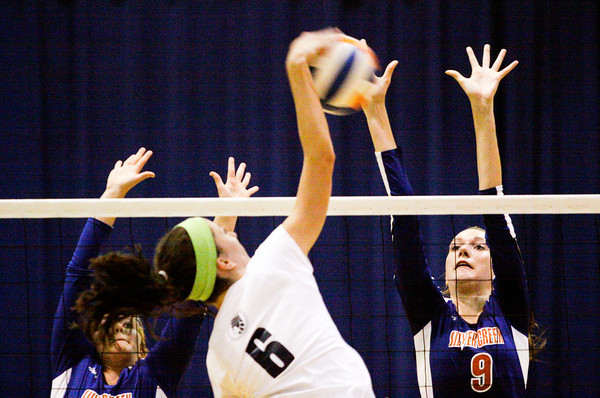 Silver Creek senior Danni Densford attempts to block a shot by Providence junior Taylor Wilson during their match in Sellersburg on Wednesday. Staff photo by Christopher Fryer