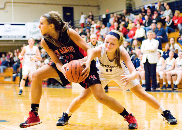 New Albany guard Jenna Shine and Providence guard Bayley Wade fight for a loose ball during their game at Providence on Friday. Staff photo by Christopher Fryer