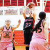 New Albany guard Lauren Camm goes up for a shot during their home game against Floyd Central on Saturday. New Albany won the game in double overtime, 69-64. Staff photo by Christopher Fryer