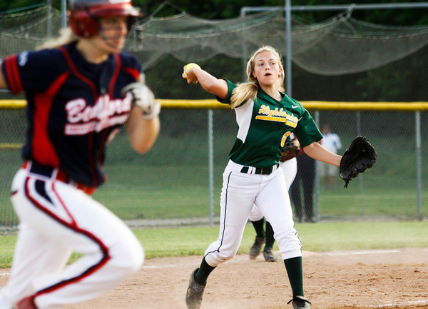 Floyd Central High School pitcher Morgan Harper turns to throw to first base for the third out of the seventh inning which sent their game against Bedford North Lawrence High School into extra innings during the Hoosier Hills Conference Softball Tournament at Floyd Central on Friday night. Floyd Central won the game, 2-1. Staff photo by Christopher Fryer