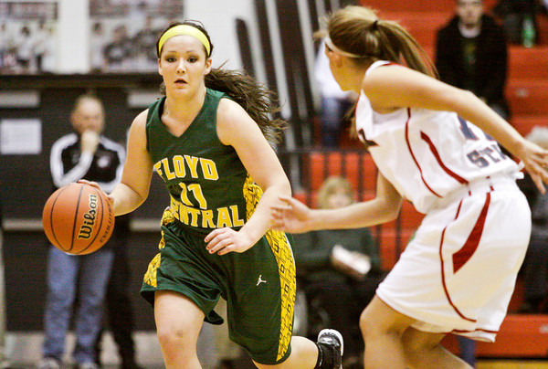Floyd Central forward Madison Kaiser moves the ball down court during their championship game against Bedford North Lawrence in the New Albany sectional tournament on Saturday. Bedford North Lawrence won the game, 54-34. Staff photo by Christopher Fryer