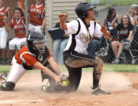 Henryville senior Sarah Richey waits for the call after scoring the winning run against Crawford County in the 2A Sectional Monday at Craford County. Staff photo by C.E. Branham