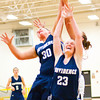 Providence center Lillian Hughes, left, and forward Claire Rauck fight for a rebound during the Pioneers' 63-37 victory over Henryville in the championship game of the Henryville Tipoff Tournament on Saturday. Staff photo by Christopher Fryer