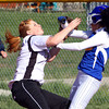 New Washington batter Ashley Johnson collides with Henryville first baseman Megan Braniff as Braniff tries to catch a pop up by Johnson. Johnson was called out on the play. Staff photo by C.E. Branham