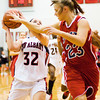 New Albany guard Brittany Knight drives to the basket during the Bulldogs' home game against Bedford North Lawrence on Tuesday. Staff photo by Christopher Fryer