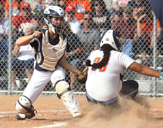 Providence catcher Jordyn Stengel tags out Switzerland County base runner Susie Reyes-Trejo for an out in the 2A regional championship Tuesday evening. Providence won 14-4. Staff photo by C.E. Branham