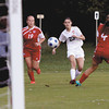 New Albany senior Taylor Brodfehrer takes a shot on goal against Jeffersonville on Wednesday night. Staff photo by C.E. Branham