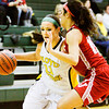Floyd Central forward Madison Kaiser drives the ball down court during the Highlanders' home game against Jeffersonville on Thursday. Staff photo by Christopher Fryer