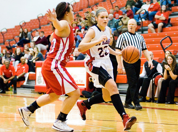 New Albany guard Lauren Camm moves the ball down court during the Bulldogs' 39-33 loss to Madison at home on Thursday. Staff photo by Christopher Fryer