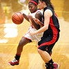 Jeff junior Aurreeshae Hines drives on New Albany defender Tanner Marcum Friday night.  Staff photo by C.E. Branham