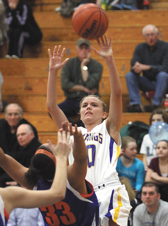 New Washington guard Kriston Sarver draws a foul from Silver Creek defender Carissa Brown at the close of the second quarter Tuesday night at New Washington.  Staff photo by C.E. Branham