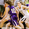 Henryville forward Abbi Robertson covers Paoli guard Morgan Kingston during their game at the Eastern Sectional on Tuesday. Staff photo by Christopher Fryer
