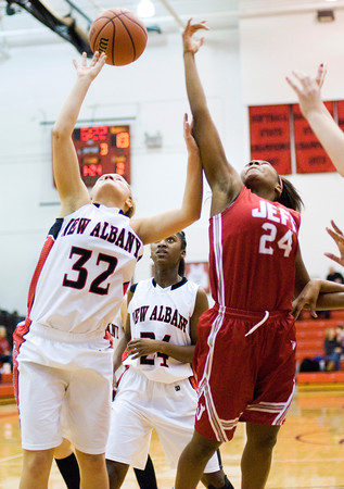 New Albany guard Brittany Knight and Jeffersonville guard Aurreeshae Hines fight for a rebound during their game at New Albany on Friday. Staff photo by Christopher Fryer