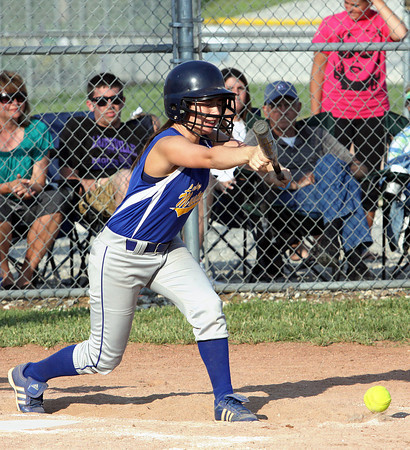 New Washington senior Whitney Leezer lays down the bunt that scored the winning run against Lanesville in the championship game of the IHSAA 1A Sectional at Lanesville. Staff photo by C.E. Branham