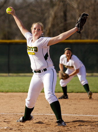 Floyd Central junior Caroline Cato pitches during their home game against New Albany on Tuesday. Floyd Central won the game, 2-1. Staff photo by Christopher Fryer