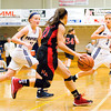 Providence guards Bayley Wade, left, and Abby Hunt double team New Albany guard Marissa Jones during their game at Providence on Friday. Staff photo by Christopher Fryer