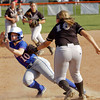 Henryville's Emma Hendricks chases down Silver Creeks' Alexis Cook for an out during the Dragons' 9-3 home win over the Hornets on Monday. Staff photo by Christopher Fryer