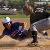 Silver Creek's Hannah Mattingly slides safely into third base during the Dragons' 9-3 home win over Henryville on Monday. Staff photo by Christopher Fryer
