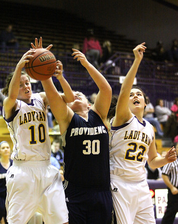 Providence sophomore Lillian Hughes grapples for a rebound with Paoli player Morgan Kingston (10) Friday night in the 2A Paoli Sectional. Staff photo by C.E. Branham
