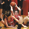 Borden senior Allison Bishop looks for a teammate after coming up with a loose ball in the 1A sectional final against New Washington Saturday night.  Staff photo by C.E. Branham