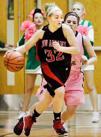 New Albany guard Brittany Knight moves the ball across the court during the Bulldogs' game at Floyd Central on Saturday. New Albany won the game, 54-46. Staff photo by Christopher Fryer