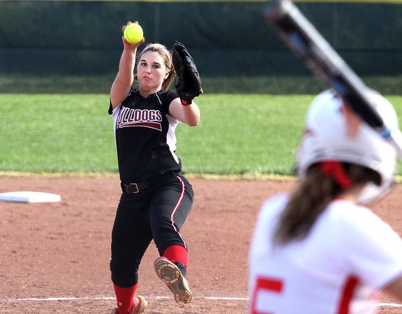 Hannah Morton delivers a pitch for New Albany in a game against Jeffersonville Monday afternoon. Staff photo by C.E. Branham