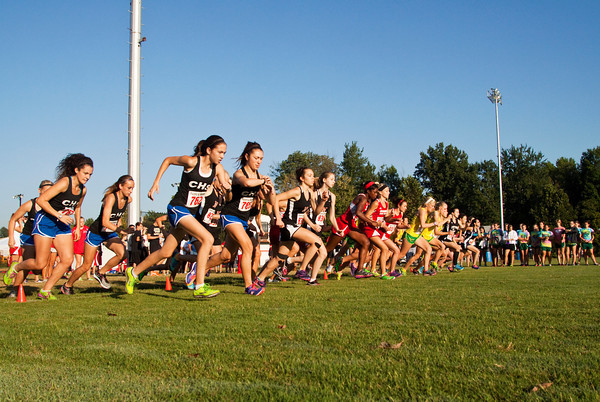 Runners leave the starting line during the women's race at the Bulldog Classic cross country invitational in New Albany on Saturday morning. Staff photo by Christopher Fryer