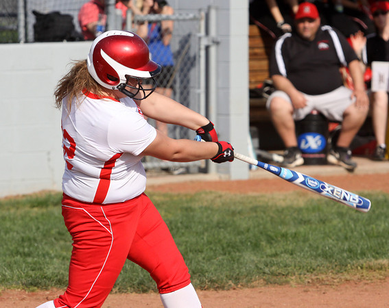 Jeffersonville batter Courtney Sheppherd delivers a single against New Albany Monday afternoon. Staff photo by C.E. Branham
