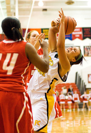 Floyd Central center Niki Bruno is fouled during their game against Jeffersonville in the New Albany sectional tournament on Tuesday. Floyd Central won the game 62-48. Staff photo by Christopher Fryer