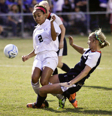 Providence midfielder Alyssa Jones and Heritage Hills defender Abby Busler struggle for possession of the ball during the second half of their regional championship game at Providence on Saturday. Providence won the game, 7-1. Staff photo by Christopher Fryer