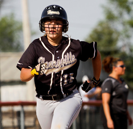 Henryville's Emily Hollis approaches home plate to score during the Hornets' 9-3 loss at Silver Creek on Monday. Staff photo by Christopher Fryer