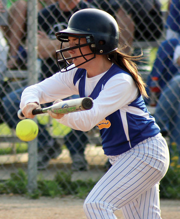 New Washington's Whitney Leezer attempts a bunt for the Mustangs during their loss to Silver Creek on Monday night. Staff photo by Elizabeth Goodman