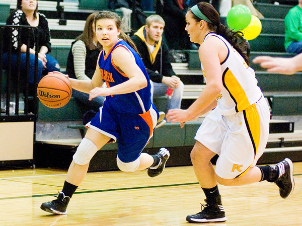 Silver Creek freshman Haley Baxter moves the ball downcourt during the Dragons' game at Floyd Central on Thursday. Staff photo by Christopher Fryer