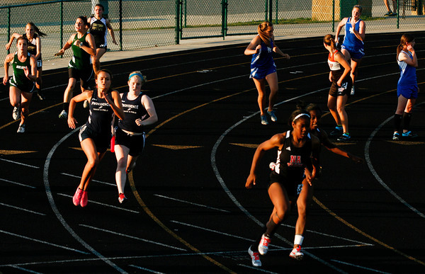Runners pass their batons during the 4x100 meter relay at the Indiana High School Athletic Association Girls Track Sectional at Floyd Central High School on Tuesday evening. Staff photo by Christopher Fryer