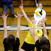 Floyd Central junior Tierney Flaherty attempts to score against Providence during their match at Providence on Tuesday. Floyd Central won the match in five sets. Staff photo by Christopher Fryer