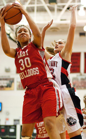 New Albany guard Lauren Camm challenges Evansville Bosse forward Dejianna Butler for a rebound during their game at New Albany on Saturday. New Albany lost the game, 57-41. Staff photo by Christopher Fryer