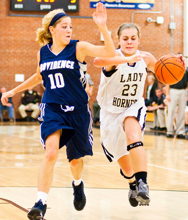 Henryville guard Emily Hollis attempts to drive past Providence guard Michaela Hoke during the championship game of the Henryville Tipoff Tournament on Saturday. The Pioneers won the game, 63-37. Staff photo by Christopher Fryer