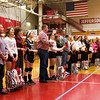 The Jeffersonville senior volleyball players stand on the gym floor while being recognized during their senior night ceremony prior to their home game against Southwestern on Wednesday. Staff photo by Christopher Fryer