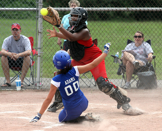 Charlestown 13-14 All-Star Brooke Adams slides in safely ahead of the throw to Jeff/GRC catcher Demetria Towns in District V play Wednesday night. Staff photo by C.E. Branham