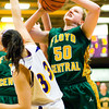 Sophomore Brianna Roth fights to make a shot during Floyd Central's game at Scottsburg on Thursday. Staff photo by Christopher Fryer