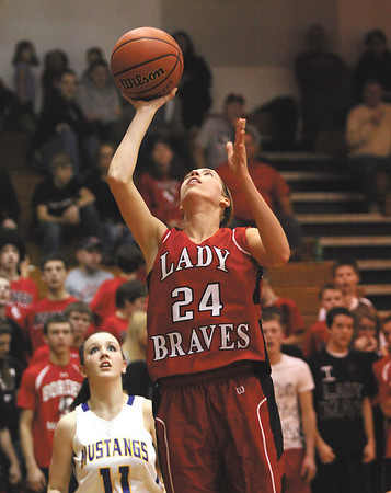 Lady Braves senior Allison Rademacher finds a easy lane to the basket against New Washington in the 1A sectional final.  Staff photo by C.E. Branham