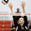 New Albany High School sophomore Alexis Lete attempts to block a shot during their match against Corydon Central High School in the River City Invitational At New Albany on Saturday morning. New Albany won the match in two games. Staff photo by Christopher Fryer