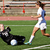 Providence keeper Autumn Meyer slides in to stop a break away by Mishawaka Marian forward D.J. Veldman during the second half of their Class A state championship game in Indianapolis on Saturday. Mishawaka Marian won the game, 2-0. Staff photo by Christopher Fryer