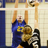 Christian Academy sophomore Krista Boesing attempts to block a shot by Rock Creek sophomore Brittney Page during their match in the first round of the Class 1A Christian Academy of Indiana Volleyball Sectional tournament on Thursday. Christian Academy won the match in three sets, 25-17, 25-11 and 25-8. Staff photo by Christopher Fryer