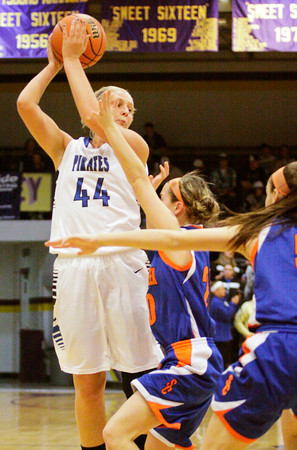 Charlestown's Emily Young looks to pass across court during their game against Silver Creek in the Scottsburg sectional tournament on Wednesday. Silver Creek won the game, 51-38. Staff photo by Christopher Fryer