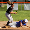 Silver Creek's McKenzie Bush slides safely into second base during the Dragons' 9-3 home win over Henryville on Monday. Staff photo by Christopher Fryer
