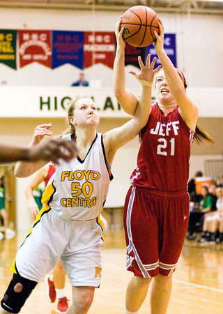 Jeffersonville center Haley Vogen comes down with a rebound during the Red Devils' game at Floyd Central on Thursday. Staff photo by Christopher Fryer