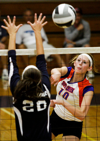 Silver Creek High School senior Sammi Smith drives the ball past Providence High School sophomore Patricia Mattingly during their match at Providence on Wednesday evening. Providence won the match in the first three sets. Staff photo by Christopher Fryer